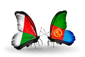 Butterflies with Madagascar and Eritrea flags — Stock Photo
