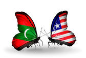 Butterflies with Maldives and Liberia flags — Stock Photo