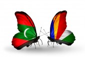 Butterflies with  Maldives and Seychelles flags — Stock Photo