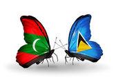蝴蝶与马尔代夫和圣卢西亚标志 — 图库照片