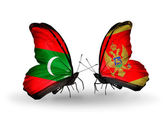 Butterflies with Maldives and Montenegro flags — Stock Photo