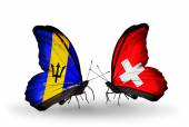 Butterflies with Barbados and Switzerland flags — Foto Stock