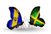 Butterflies with Barbados and Jamaica flags — Stock Photo