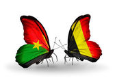 Two butterflies with flags — Stock Photo