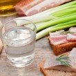 Vodka, green onion, cucumber and bacon sandwiches and herring — Stock Photo #57748925