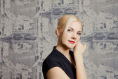 Blond woman on the background of interior — Stock Photo