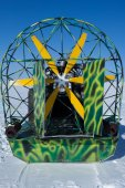 Snowmobile green with yellow propeller — Stock Photo