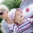Baby girl in the sun hat with her young mother — Stock Photo #51965517