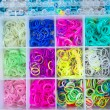 Box with colorful rubber bands for rainbow loom — Stock Photo #53453775