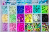 Box with colorful rubber bands for rainbow loom — Stock Photo