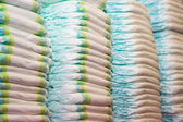 Children's diapers stacked in a piles — Stock Photo