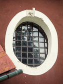 Old barred window — Stock Photo