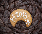 The title PF 2015 written on gingerbread cookie — Stock Photo
