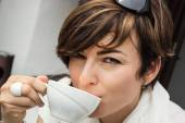 Young caucasian woman with coffee — Stock Photo