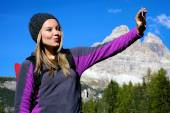 Blonde young woman tacking selfie photo  — Stock Photo