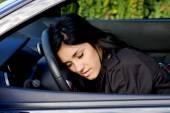 Woman falling asleep on wheel in car drunk — Stock Photo