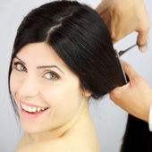 Woman happy about new haircut from long to short — Stockfoto