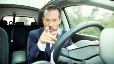 Happy laughing businessman  driving automobile — Stock Video
