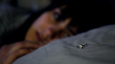 Sad woman looking at ring — Stock Video