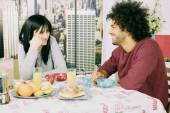 Smiling couple looking at each other during breakfast — Stock Photo