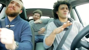 Three young men in car dancing — Stockvideo