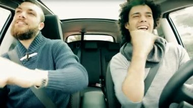 Two young men in car dancing — Stok video