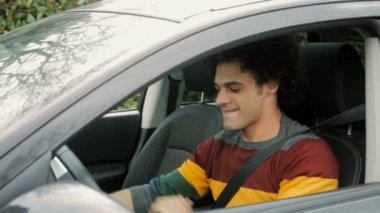 Young  man fastening safety belt — Stock Video