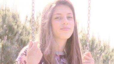 Woman sitting on swing — Stock Video