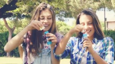 Young women with soap bubbles — Stock Video