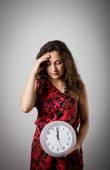 Girl and clock. — Stock Photo