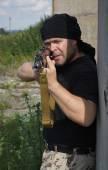 Człowiek z pistoletu — Zdjęcie stockowe