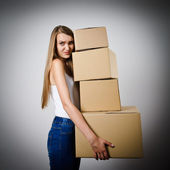 Woman and cardboards. — Stock Photo