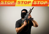 Man with gun and STOP line. — Stock Photo