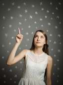 Girl in white and snowflakes. — Stock Photo