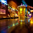 Pint of beer on a bar — Stock Photo #60210721
