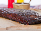 Fresh BBQ ribs on a wooden  board — Stock Photo