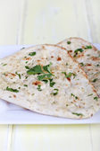 Naan bread with corriander — Stock Photo