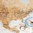 Travel destination United States, ancient map with vintage compass — Stock Photo #53430839