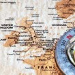 Travel destination United Kingdom and Ireland, ancient map with vintage compass — Stock Photo #53431157