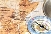 Travel destination Tanzania and Kenya, ancient map with vintage compass — Stock Photo
