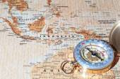 Travel destination Indonesia, ancient map with vintage compass — Stock Photo
