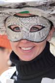 Young woman wearing a newspapers mask — Stockfoto