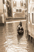 Gondolier carrying tourists in Venice, sepia tone — Stock Photo