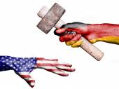 Germany hitting United States with a heavy hammer — Stock Photo
