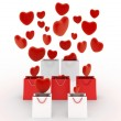 Hearts falling into gift bags — Stock Photo #52928345