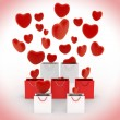 Hearts falling into gift bags — Stock Photo #54337773