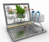 Concept of Christmas online shopping. Laptop computer  with festive shopping carts on white background — Stock Photo