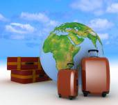 Suitcases for travel on the background of the globe — Stock Photo
