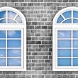 3d windows on the brick wall, with the reflection of the sky in them — Stock Photo #67102931
