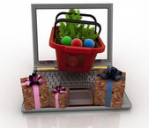 Laptop computer with festive shopping baskets. Concept of Christmas online shopping — Stock Photo